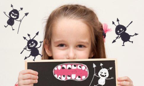 女の子と虫歯